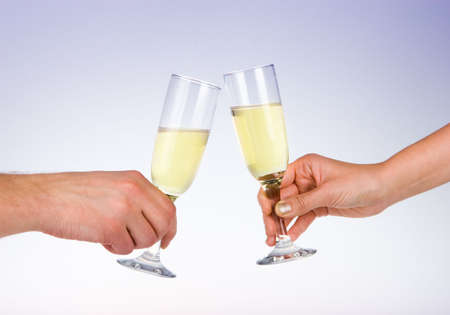 Two wine glasses toasting photo