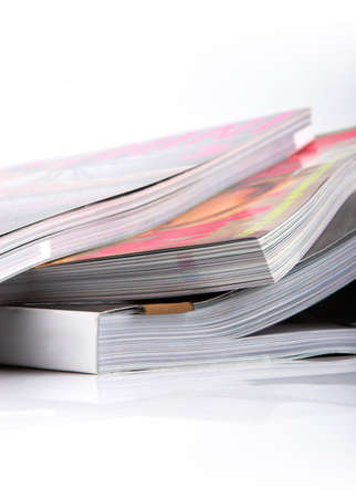 Stack of glossy magazines on a white background. Stock Photo - 2990471