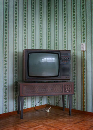 broadcasting: Retro grunge tv against wallpaper wall.
