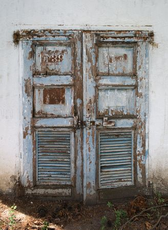 Over the years the door have had many layers of coloured paint. Stock Photo - 3344059