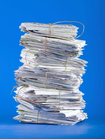 Pile of envelopes, letters, bills, forms. Isolated on blue 版權商用圖片
