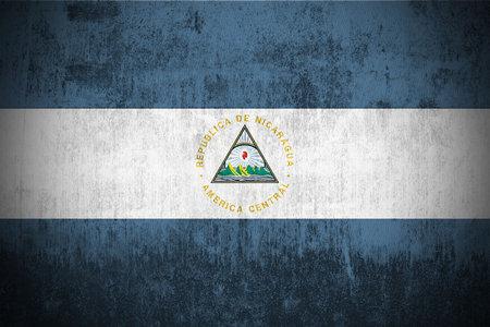 Weathered Flag Of Nicaragua, fabric textured   photo
