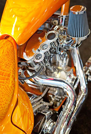 Chrome engine on a custom motorcycle close up.  photo