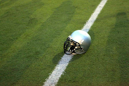 American Football Helmet on the Field with room for copy photo