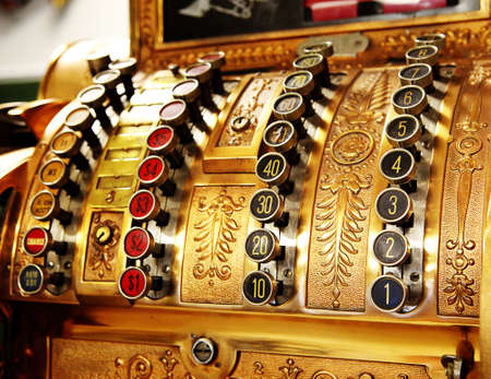 antique store cash register buttons close photo