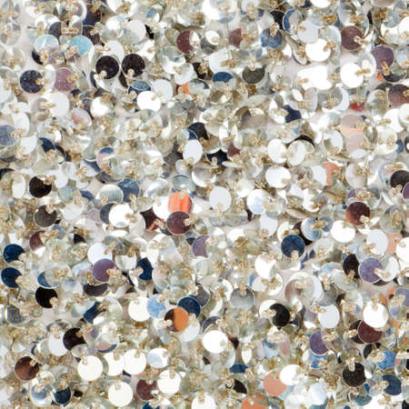 glitter: Silver sequins pattern texture fashion background Stock Photo