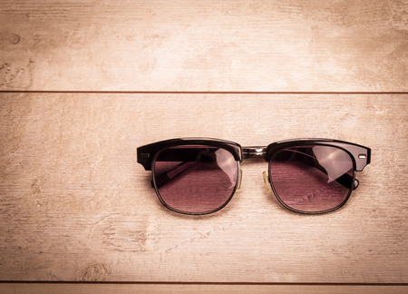 black sunglasses on wood floor Stock Photo