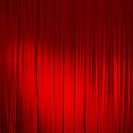 Rood gesloten gordijn met lichte vlekken in een theater. Stockfoto