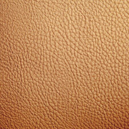 Tan leather texture background. Close-up photo Фото со стока