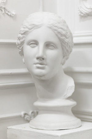 White marble head of young woman isolated on white Foto de archivo