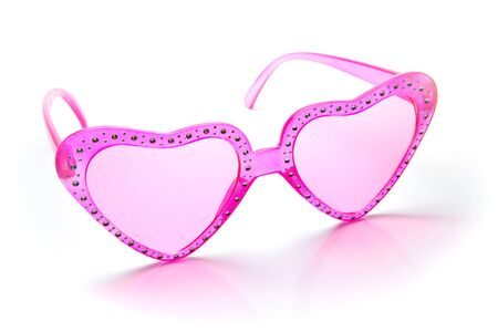 Pink heart shaped sunglasses on white background Stock Photo