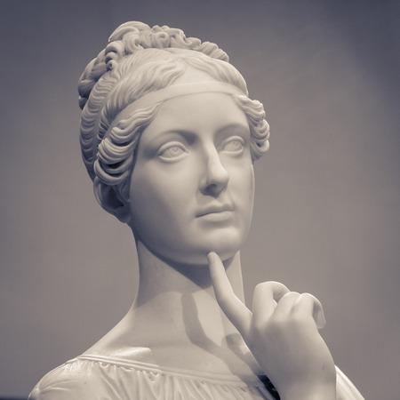 White marble head of young woman.