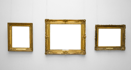 Three gold empty frame on white wall.