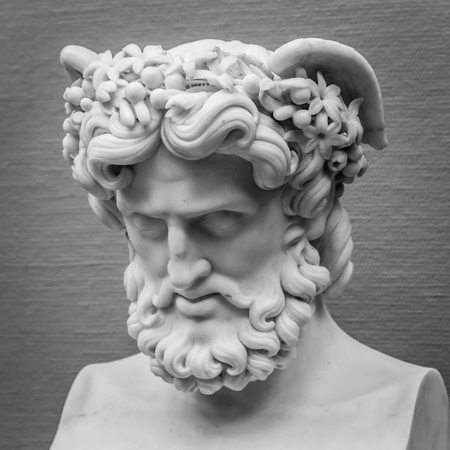 Head and shoulders detail of the ancient sculpture. Banco de Imagens