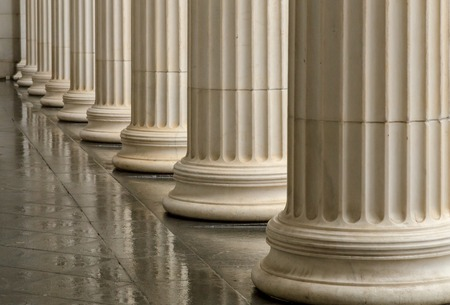 Many old greek columns with reflection.