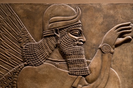 Ancient relief of an assyrian god.