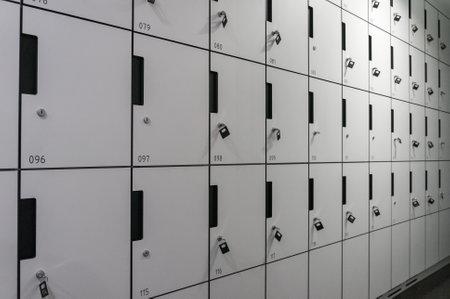 row of locker box - stainless steel panel key lock numbers