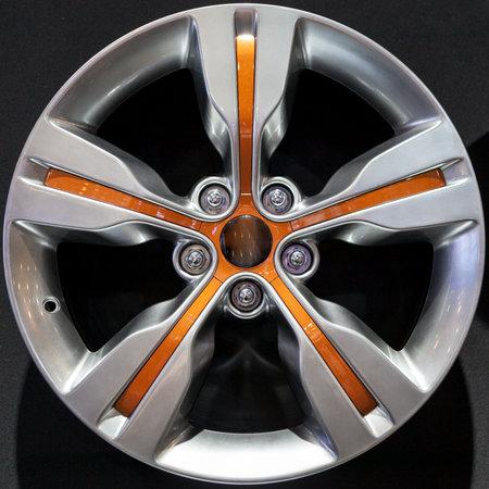 Car alloy rim on black background.