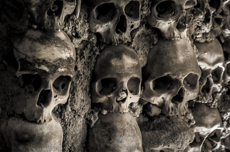 Wall of skulls and bones in the bone chapel in Evora, Portugal