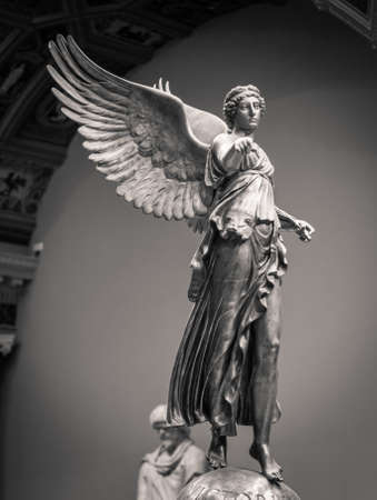 Roman classical statue of Victory woman with wings.