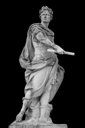 Roman emperor Julius Caesar statue isolated over black background Foto de archivo