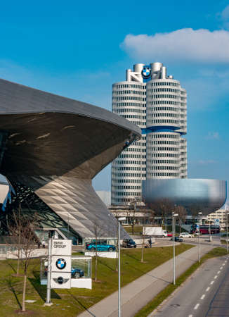 Munich, Germany - March 10, 2016: BMW four-cylinder tower Munich landmark which serves as world headquarters for Bavarian automaker. Stock photo with elements of designs Museum and Welt world Standard-Bild - 106467812