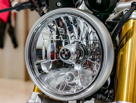 Moscow, Russia - March 17, 2018: A shallow focus shot of the front headlight of a vintage BMW motorcycle. Éditoriale
