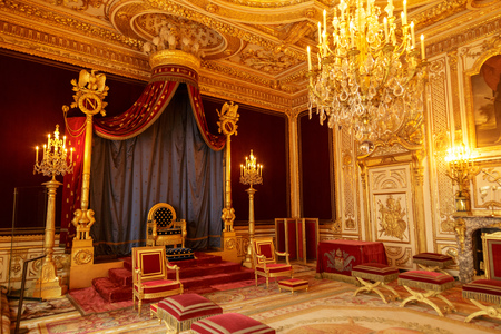 Paris, France, March 31, 2017: Fontainebleau Palace interiors. The Throne Room. Chateau was one of the main palaces of French kings Redactioneel