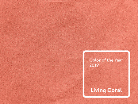 Living Coral color of the Year 2019. Paper texture background with coral in trendy color