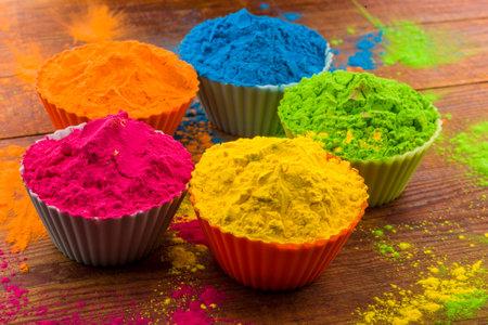 Holi color powder. Organic Gulal colours in bowl for Holi festival, Hindu tradition festive