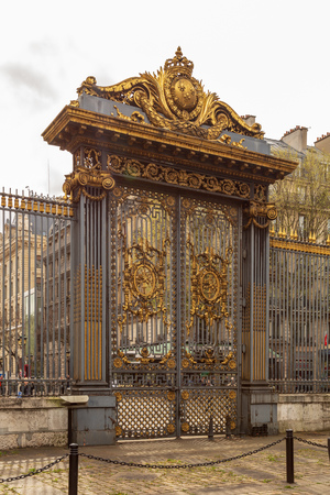 Paris, France - 1 April, 2017: Golden gate of palace of courthouse called palais de justice in french language in Paris France Editorial
