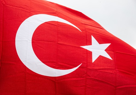 Flag of Turkey waving in the wind with highly detailed fabric texture