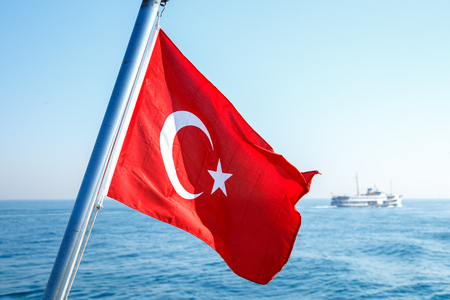 The flag scene from Turkey. The Turkish flag is fluctuating in the ferry on the sea
