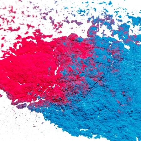 Abstract colorful Happy Holi background. Color vibrant powder isolated on white. Dust colored splash texture. Фото со стока