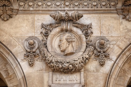 Paris, France, March 31, 2017: Architectural details of Opera National de Paris. Haydn Facade sculpture. Grand Opera is famous neo-baroque building in Paris, France - UNESCO World Heritage Site