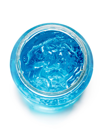 Blue gel container isolated on white background from top view. Transparent gel with bubbles close-up Reklamní fotografie