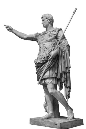 Caesar Augustus, the first emperor of Ancient Rome. Bronze monumental statue in the center of Rome isolated on white background by clipping path Stock Photo