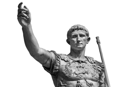 Caesar Augustus, the first emperor of Ancient Rome. Bronze monumental statue in the center of Rome isolated on white background Stock Photo