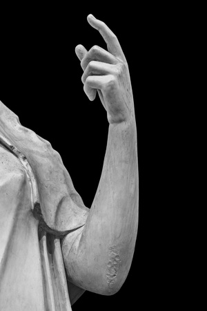 Stone statue detail of human hand isolated on black background by clipping path