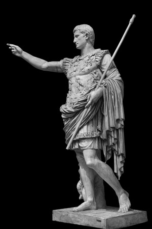 Caesar Augustus, the first emperor of Ancient Rome. Bronze monumental statue in the center of Rome isolated on black background by clipping path Stock Photo