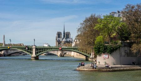 Paris, France, March 30, 2017: Paris Bridge. Bridges of Paris over Seine River, on a beautiful cloudy day. No less than 37 bridges span Seine, river that separates Left and Right banks of Paris Editorial