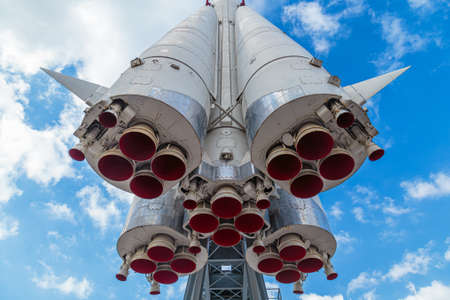 Rocket engine and red nozzle engines on the background of blue sky. Monument - rocket to launch spaceships. Russia, Moscow