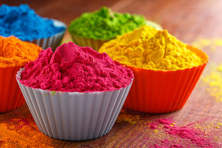 Colorful traditional holi powder in bowls. Happy holi. Concept Indian color festival called Holi. Organic Gulal dust 版權商用圖片