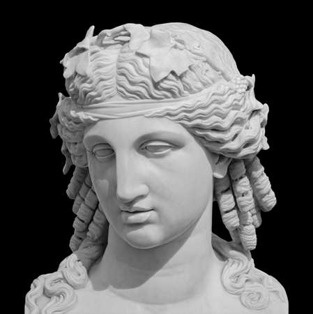 Ancient white marble sculpture head of young woman. Statue of sensual renaissance art era woman antique style. Face isolated on black background