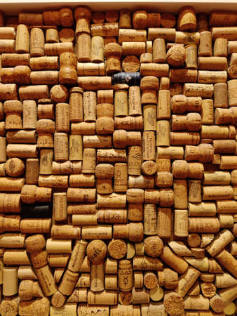 Saint-Petersburg, RUSSIA - March 25, 2021 : Wine corks background. Closeup pattern background of many different wine corks with dates and drops of wine