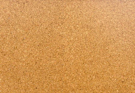 Brown and yellow color of cork board. Textured wooden background. Cork board with copy space. Notice board or bulletin board image. 版權商用圖片