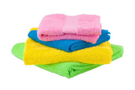 Towel isolated on white background. Stack of colorful towels 版權商用圖片