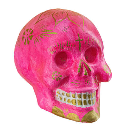 Typical Mexican skull painted isolated on white background. Dia de los muertos. Creative and minimal Day of the Dead or Halloween layout. Skull pink 版權商用圖片