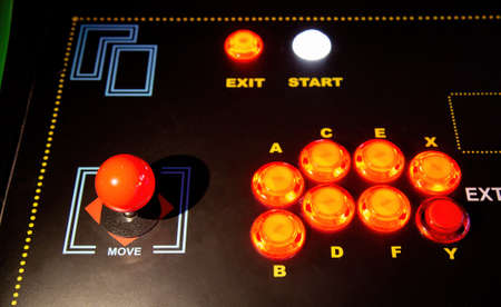 Gamepad with joystick and many colorful buttons. Retro arcade old video game stick control