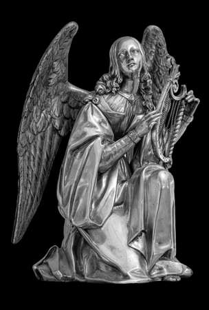 Angel with Harp. Muse statue isolated on black background 版權商用圖片